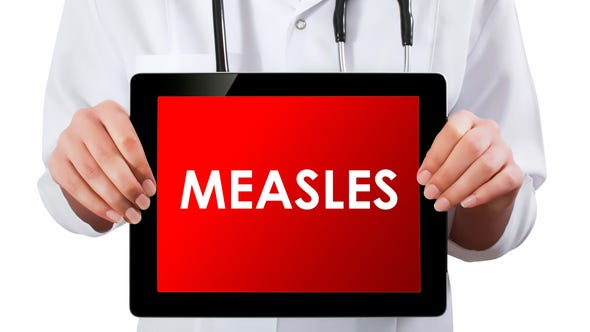 Do adults who were vaccinated as children need to worry about whether they need additional protection from measles?