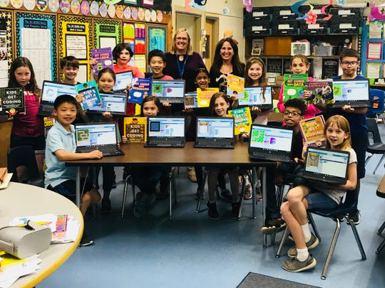 Pictured are students from Grades 3-5 who participated in Beginning Coding this spring with Catharine Halloran who teaches 3rd grade and Sally Susan Heyder who is the Media Specialist.