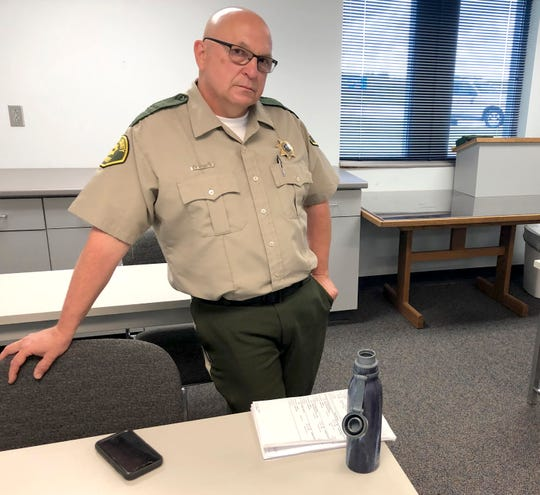 Cedar County Sheriff Warren Wethington poses for a portrait at his office in Tipton, Iowa, on Wednesday, June 12, 2019. Wethington has declared that his jail will not book any inmates arrested by police officers in the town of Durant, saying he cannot vouch for the officers' integrity.
