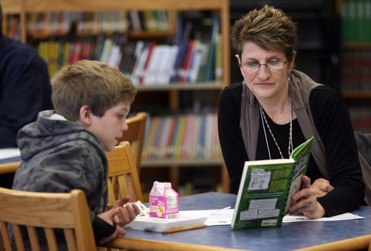 Everybody Wins! Iowa mentor Luann Smith reads with Jeffallen Sigler, 9, of Des Moines at South Union Elementary School in 2011.