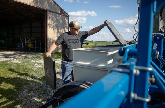 Jason Carter tends to his planter after finishing up planting soybeans on Wednesday, June 12, 2019, at a farm in rural Knoxville that he rents with his wife, Shelly. The Carters are trying to return to a normal life after Jason was found not guilty in the shooting death of his mother, Shirley.