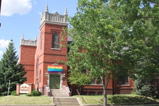 "The United Church of Christ is seen in Ames, Iowa. The banner above the doorway reads ""God is still speaking."" The banner was stolen and lit on fire on early Tuesday morning."