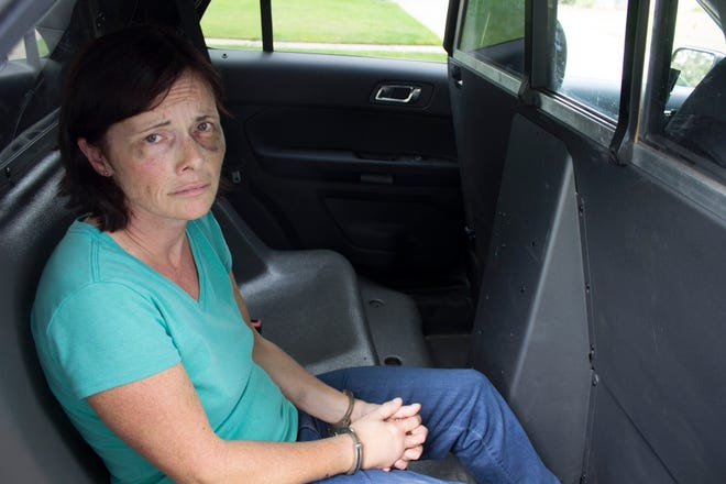 Tina Talbot is shown on the day she was arrested in the fatal shooting of her husband, Milosz Szczepanowicz. This Waterford Police photo was provided to the Free Press by her friend, Janene Staley.