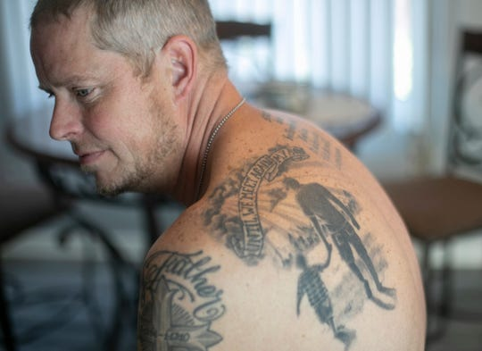 Andy Hopson, 51 of Livonia, a recovering addict, talks about the loss of his son Dakota, who died on May, 5, 2016 of a heroin overdose. He had many tatoos memorializing his son including a likeness of them walking hand-in-hand.