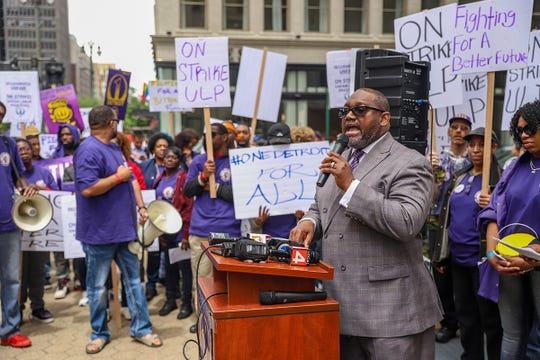 Rev. Kenneth J. Flowers, of Greater New Mount Moriah Missionary Baptist church, speaks during a rally in front of the Ally building in downtown Detroit after a planned walkout and strike Thursday, June 13, 2019, by private nonunion security guards at Bedrock-owned buildings in downtown Detroit. The strike had been announced by Service Employees International Union Local 1, which wants to organize the workers and help them push for $15 hourly wages.