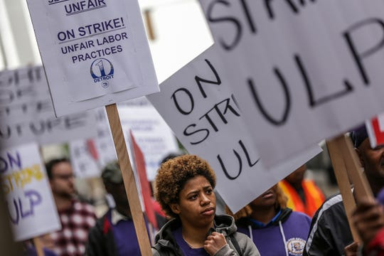 Aleia Lockeridge, 20, of Detroit marches with Service Employees International Union Local 1, in solidarity with nonunion security guards at Bedrock-owned buildings in downtown Detroit in front of the Ally building in downtown Detroit after a planned walkout and strike on Thursday, June 13, 2019. The strike was announced by SEIU, which wants to organize the workers and help them push for $15 hourly wages.