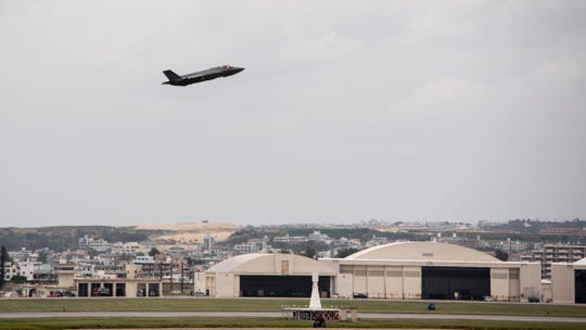 In this Nov. 16, 2017 photo made available by the U.S. Air Force, a fighter plane takes-off from Kadena Air Base, Japan.