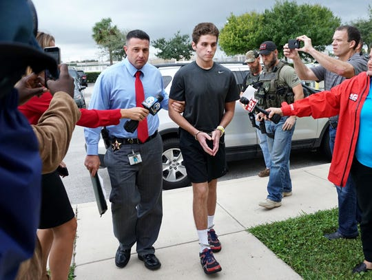 Austin Harrouff is transported by detectives to the Martin County Jail from St. Mary's Hospital in this Oct. 3, 2016, file photo.
