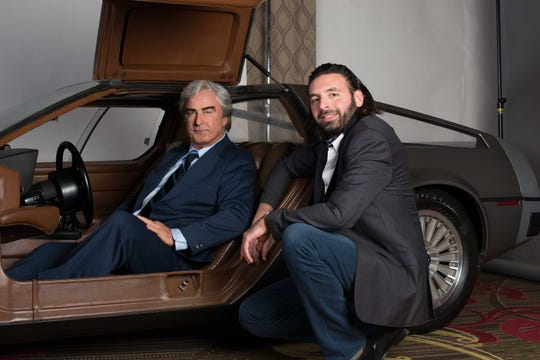 """Alec Baldwin as John DeLorean sits in a DeLorean sports car with """"Framing John DeLorean"""" producer Tamir Ardon. Ardon's movie about the famous automaker debuts June 14 in theaters nationwide."""