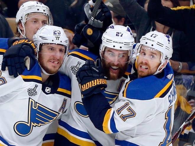 St. Louis' Alex Pietrangelo, second from right, celebrates his goal with teammates Jay Bouwmeester, left rear, Alexander Steen, left, and Jaden Schwartz, right, during the first period.