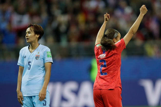 Thailand's Ainon Phancha, left, looks at the goal as the United States' Mallory Pugh celebrates after scoring her 10th goal during the World Cup match.