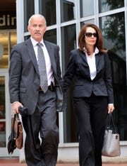 (Caption) Former Michigan Supreme Court Justice Diane Hathaway walks out of the Federal Building in Ann Arbor with her attorney Steve Fishman after her sentencing for bank fraud Tuesday afternoon. Photos taken on Tuesday, Monday, May 28, 2013. ( John T. Greilick / The Detroit News )______
