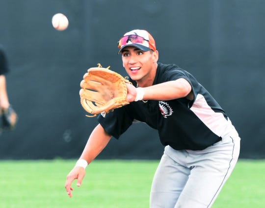 Tito Flores does some infield work during practice on Wednesday.