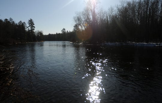 Officials say an education plan will be put into place, instead of a ban on alcoholic beverages, along three popular rivers in northern Michigan including the Au Sable River, shown.