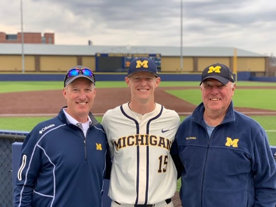 From left, Derek Kerr, Jimmy Kerr and John Kerr at Michigan's Ray Fisher Stadium.