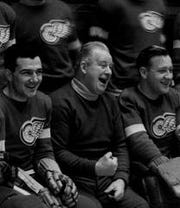 Red Wings coach Jack Adams with his players in 1936.
