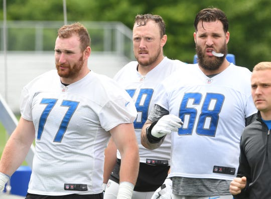 Lions offensive linemen Frank Ragnow, Kenny Wiggins and Taylor Decker walk off the field after practice this week.