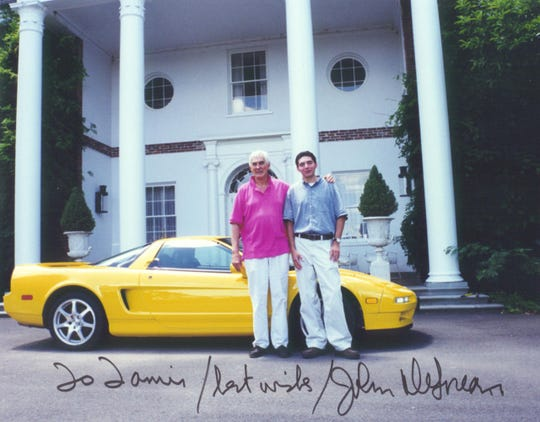 """John DeLorean, left, is seen in an autographed picture with Tamir Ardon. DeLorean died in 2005 and Ardon produced the biographical film, """"Framing John DeLorean,"""" which debuts June 14."""