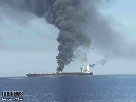 In this photo released by state-run IRIB News Agency, an oil tanker is on fire in the sea of Oman, Thursday, June 13, 2019. Two oil tankers near the strategic Strait of Hormuz have been reportedly attacked. The alleged assault on Thursday left one ablaze and adrift as sailors were evacuated from both vessels.