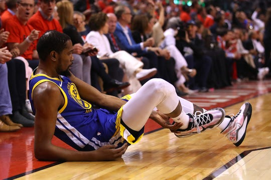 Kevin Durant reacts after sustaining an injury during Game 5.