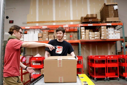 In this Nov. 16, 2018, file photo, Target employees sort boxed items from online orders to be shipped out to customers at at a Target store in Edison, N.J. Target is offering same-day delivery on thousands of items for $9.99 per order through a delivery startup it purchased nearly two years ago.