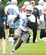 Lions running back Kerryon Johnson cuts up field during drills.