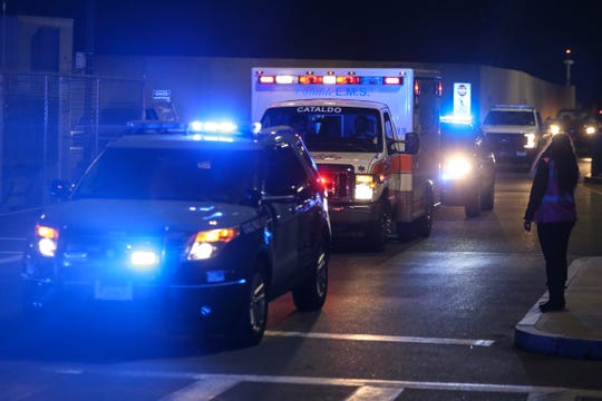 An ambulance carrying David Ortiz is escorted to Mass General Hospital in Boston on Monday night.