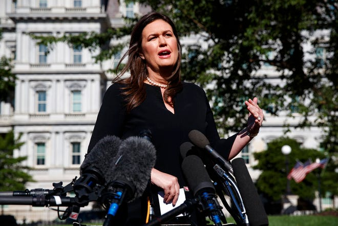 White House press secretary Sarah Sanders talks with reporters outside the White House, Tuesday, June 11, 2019, in Washington.  Sanders will be leaving the Trump administration at the end of the month.