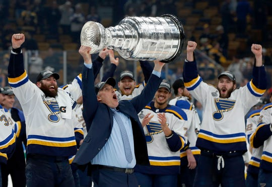 St. Louis Blues head coach Craig Berube carries the Stanley Cup on Wednesday night.