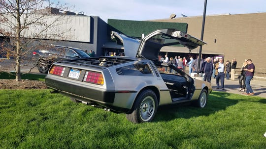 """A DeLorean sports car is parked in front of Birmingham's Maple Theatre, where the movie """"Framing John DeLorean"""" premiered May 14 at the Cinetopia Film Festival. The movie opens nationally June 14."""
