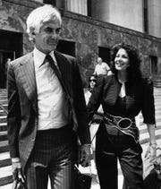 John DeLorean and his third wife, Cristina Ferrare, are all smiles as they leave Federal Court in Los Angeles in May 1984. DeLorean was acquitted of drug trafficking charges after the jury decided that he had been entrapped by the government. Shortly after the trial ended Cristina and he divorced.