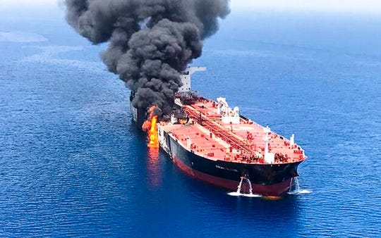An oil tanker is on fire in the sea of Oman, Thursday, June 13, 2019. U.S. Secretary of State Mike Pompeo says the U.S. believes that Iran is responsible for attacks that damaged two oil tankers near the Persian Gulf.