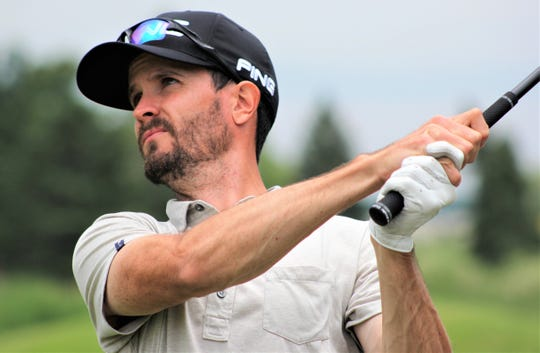 Eric Lilleboe of Okemos leads the Michigan Open.