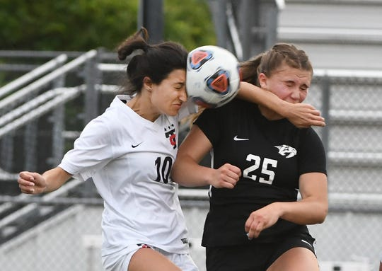 Troy's Mila Palincas and Plymouth's Rebecca Przybylo battle for a ball in the second half.