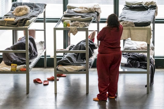 The common area of the women's pod is filled with portable beds due to overcrowding at the Vanderburgh County Detention Center in Evansville, Ind., Thursday, May 23, 2019. Vanderburgh County's jail population routinely teeters above 800, with dozens of those inmates transported at taxpayer expense to nearby Indiana, Kentucky and Illinois counties because the local lockup is too full.