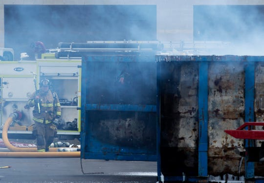Two construction dumpsters continue to burn behind St. Vincent Orthopaedic Hospital at 10388 Warrick Wellness Trail as firefighters work to extinguish the fire Thursday afternoon. Nobody was injured and the facility still plans to open June 29, 2019.