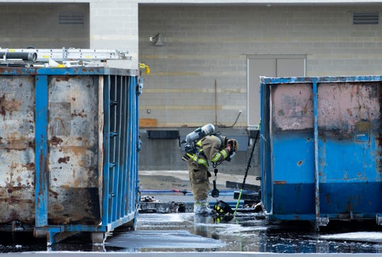 A firefighter with the Ohio Township Fire Department prepares to continue fighting the fire in two construction dumpsters behind St. Vincent Orthopaedic Hospital at 10388 Warrick Wellness Trail Thursday afternoon. Nobody was injured and the facility still plans to open June 29, 2019.