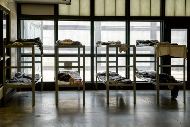 The common area of the women's pod is filled with portable beds due to overcrowding at the Vanderburgh County Detention Center in Evansville, Ind., Thursday, May 23, 2019.