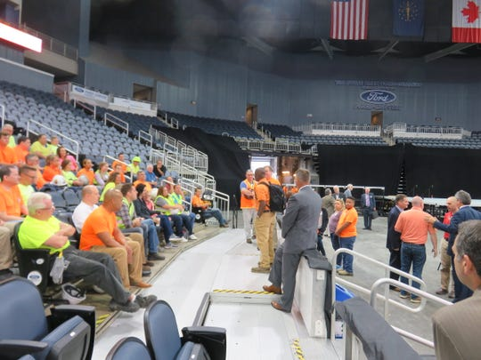Between 900-1000 volunteers worked to clean and prepare the Ford Center for the convention Thursday.