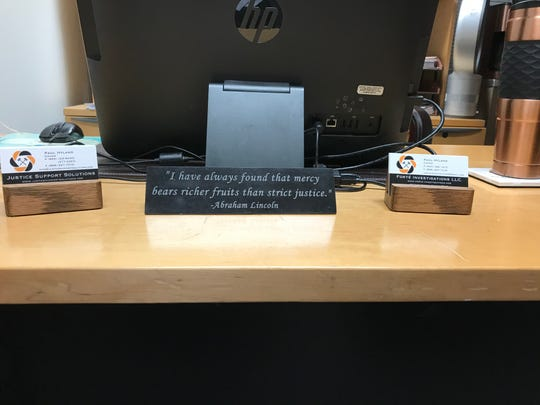 "A plaque on Paul Hyland's desk bears an Abraham Lincoln quote, which reads ""I have always found that mercy bears richer fruits than strict justice."""