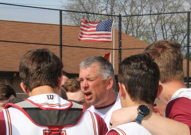 Then-Watterson coach Scott Manahan talks with his team.