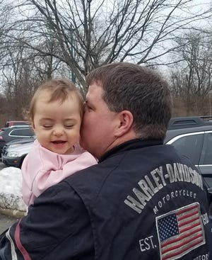 Steve Powlett holds Kara Grace. Powlett's family submitted his photo to The News-Messenger for our Father's Day photo gallery.