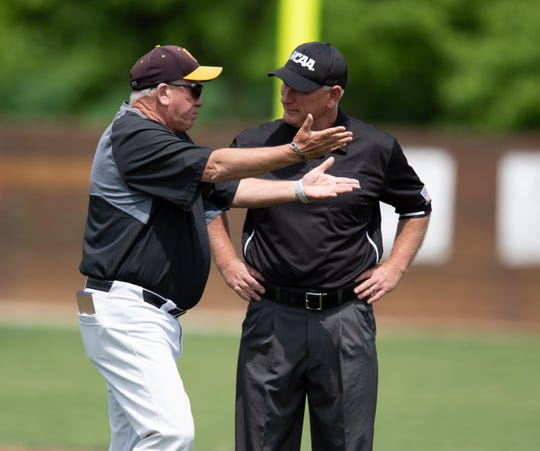 College of Wooster coach Tim Pettorini discusses the scenario with an umpire.