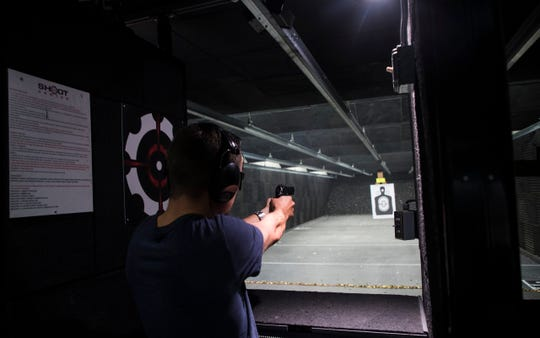 Customers practice shooting skills in the range at the Shoot Center in Cape Coral. The center changed some of its policies after a suicide by shooting last year in the gun range.