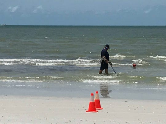 Lee County Sheriff's deputies are on Fort Myers Beach searching for evidence Thursday, 6-13-2019.
