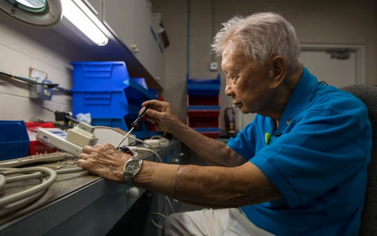 "Ponciano ""Poncho"" Mauricio, 101, of Cape Coral, works on a repair for a communication device in the plant operations building of Cape Coral Hospital Thursday morning June 13, 2019. Mauricio is still an active volunteer for Lee Health contributing in various capacities at the hospital."