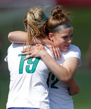 Green Bay Notre Dame's Jenna Cuene (19) and Keighley Blindauer (12) embrace after a semifinal loss to Madison Edgewood during the WIAA Division 3 state soccer tournament in Milwaukee.