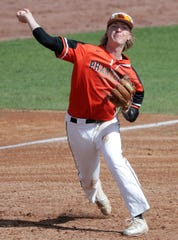 West De Pere's Cameron Dupont makes a throw from third on Thursday.