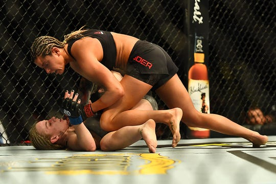 "Ashley ""Spider Monkey"" Yoder gains the upper hand against Amanda Cooper at UFC Fight Night 139 in Denver last November."
