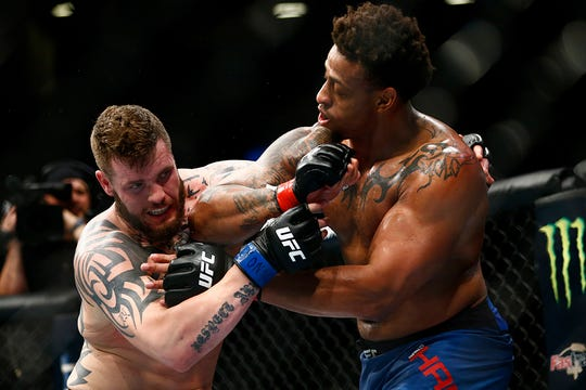 Allen Crowder, left, battles Greg Hardy in his last UFC fight in January; Crowder won when Hardy was disqualified.